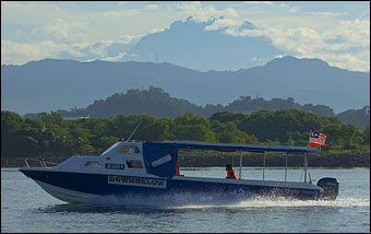 Our Dive Boat with the Stunning backdrop of Mt Kinabalu