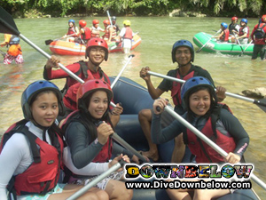 Having fun white water rafting on the Kiulu River