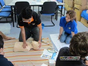 Practicing child CPR skills under the watchful eye of Jo, the EFR Instructor
