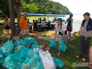Glamorgan students unloading Gaya island trash from the Downbelow boats