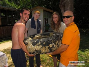 Richard, in orange, with some of the Glamorgan Uni students and 1 of 4 big truck tires removed from the Gaya Island swamp