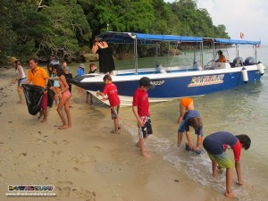 The Australian International School kids land on the deserted beach and gets right at it collecting trash