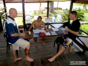 Resident PADI Course Director Richard Swann giving exam advice to Steve and Shevy