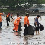 Volunteers to the rescue during the UiTM Save Our Beach 2011 clean-up campaign
