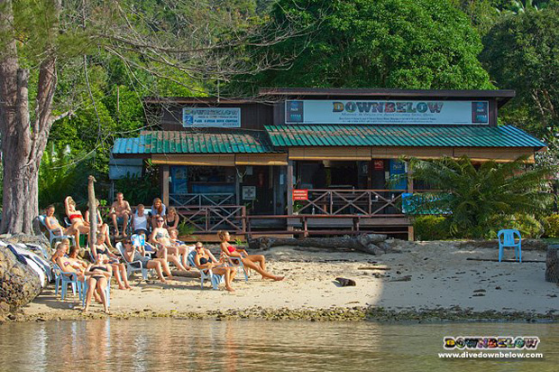 The Danish Group catching some early morning sun on the beach in front of the dive centre on Gaya island
