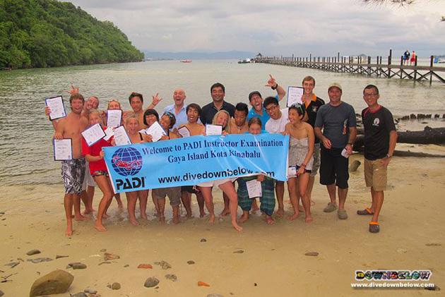 Happy PADI Instructor Exam participants at our dive station on Gaya island in Kota Kinabalu