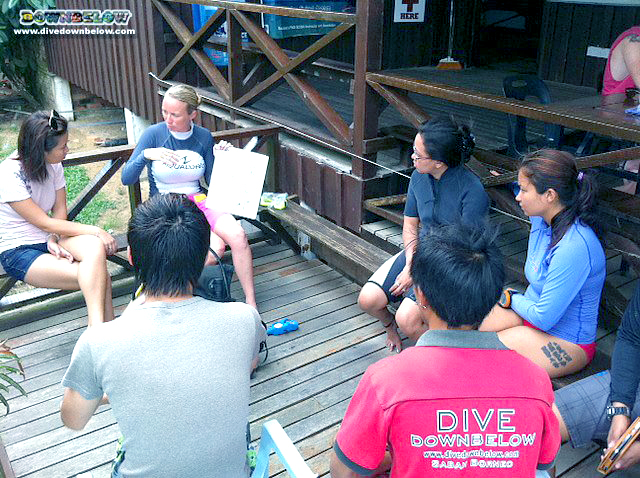 Kim conducts a Discover Scuba Diving experience with seasoned instructor Cyril keeping an eye