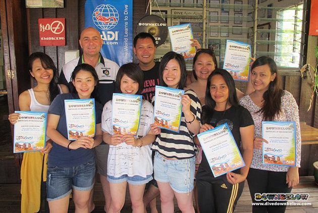 Resident PADI Course Director Richard Swann with the staff from Shangri La's Rasa Ria Resort.