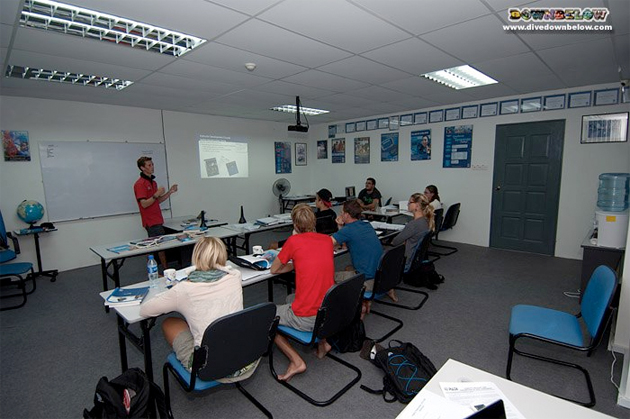 Downbelow's Go Pro Instructor Paul presents a module as part of the PADI Instructor Development Course in Sabah, Malaysia