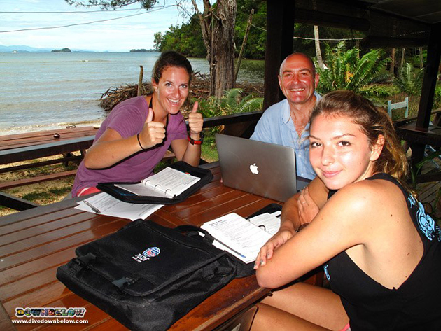 Meredith, Richard and Jess going through the PADI coursework