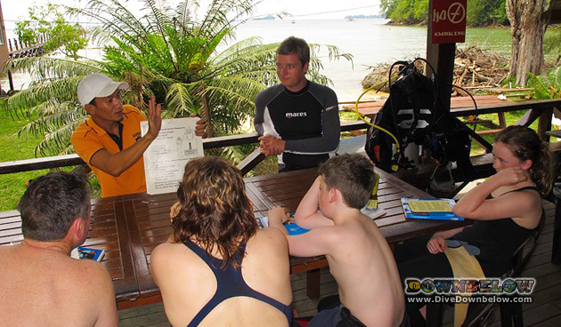 Luke learning the ropes from Wellson presenting the PADI Open Water Course to this family