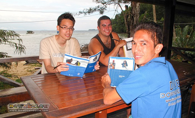 Downbelow's guest Dr. Cheah on the left with Sam in the middle and local intern Awang on the right during the recent PADI Rescue Diver course