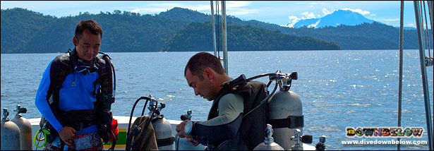 Diver getting ready to dive within view of Mt. Kinabalu
