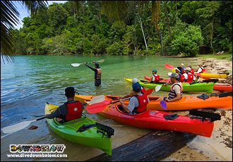 Sea Kayakers getting a safety briefing before launching from Gaya Island